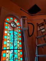 Honey Bees Flying to the Stained Glass Window of a Columbus Georgia Church During Removal of the Hive